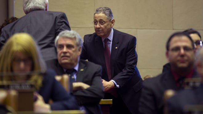 Assemblyman Sheldon Silver, D-Manhattan, stands at his desk in the Assembly Chamber on Feb. 3, 2015, in Albany.