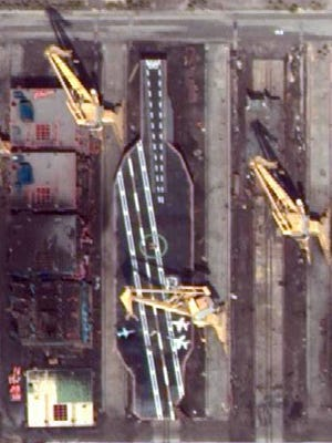 3/23/2014 _ Iran appears to be constructing an American Nimitz Class (CVN 68) aircraft carrier near Bandar Abbas as observed through commercial satellite imagery.  The U.S. Navy believes that this is NOT a functioning aircraft carrier, but rather a mock-up of an actual U.S. Nimitz Class (CVN 68) carrier.  Pontoons with steel construction to replicate hull, flight deck and superstructure.  Handout image courtesy of DigitalGlobe via U.S. Navy [Via MerlinFTP Drop]