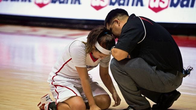 Larenson Henderson, seen here consoling Ashley John after Shiprock lost in the 3A girls state championship game on March 14, 2014, in Albuquerque, was named Farmington's head girls basketball coach. Henderson spent the past six seasons at Shiprock, winning a state title in 2017, making the state finals twice and the state semifinals three times.