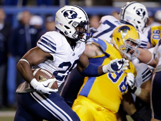 BYU running back Adam Hine (28) carries the ball against San Jose State  during the first half of an NCAA college football game Friday, Nov. 6, 2015, in San Jose, Calif.