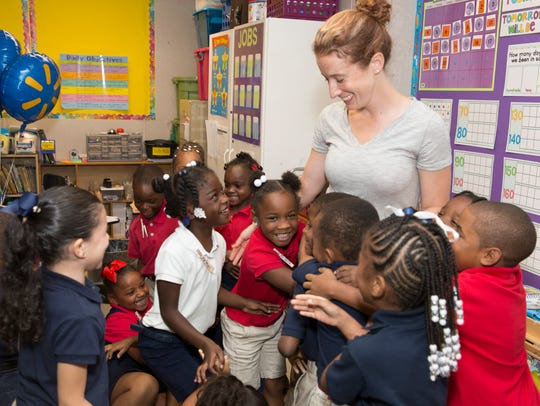 In September 2016, a teacher at Alice Boucher Elementary receives hugs from her students after she was awarded a Walmart gift card. This year, Alice Boucher achieved 'C' status for the first time.