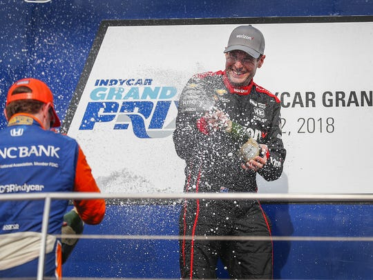 Team Penske IndyCar driver Will Power (12) celebrates