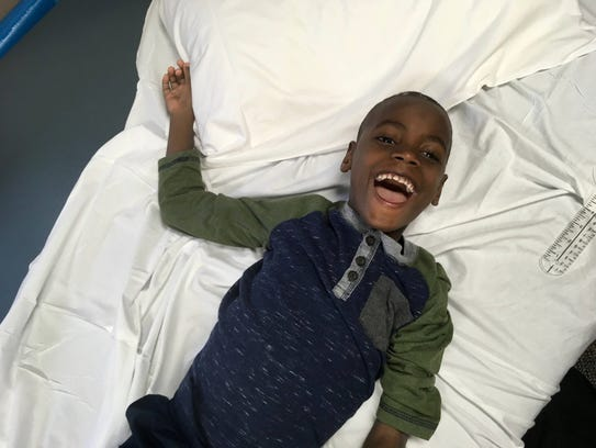 Knox Joasil, a 6-year-old Haitian boy brought to the U.S. to receive treatment for brain injury complications, sees America as a wondrous place.
