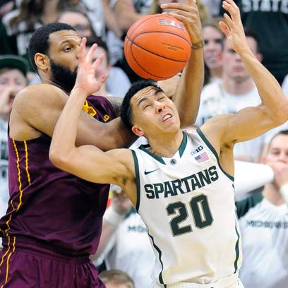 MSU's Travis Trice steals the ball from Minnesota's