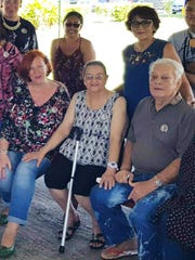 Erika Entenmann, granddaughter of Hermann Woitschek, is shown in Saipan with Jovie Tomokane, center and Jose Cepeda, right, and behind him Sally Villanueva -- four of the nine remaining grandchildren still alive. Woitschek had 30 total grandchildren.