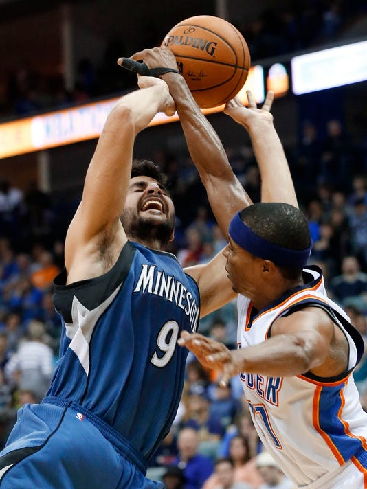 Oklahoma City Thunder guard Sebastian Telfair, right, knocks the ball away from Minnesota Timberwolves guard Ricky Rubio (9) in the fourth quarter of an NBA preseason basketball game in Tulsa, Okla., Sunday, Oct. 19, 2014. Minnesota won 112-94. (AP Photo/Sue Ogrocki)