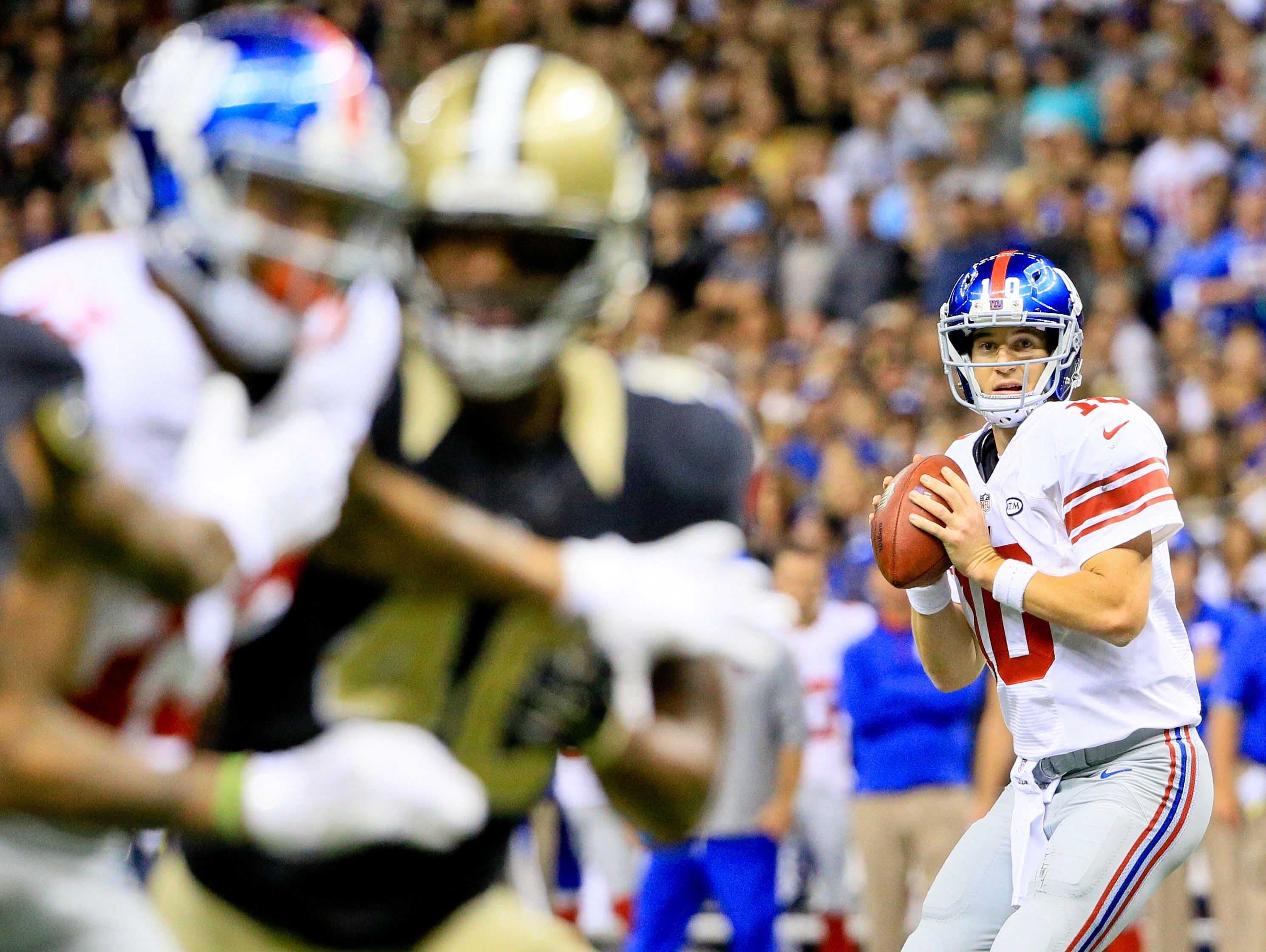 New York Giants quarterback Eli Manning (10) looks to pass against the New Orleans Saints during the second half.