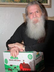 Rex Kunz receives his box of food items from Meals