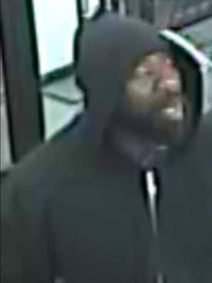 A photograph of an armed robbery suspect in Des Moines.