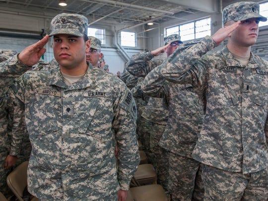 Spc. Jose G. Arroyo (left) and 1st Lt. Kyle B. Cozart,