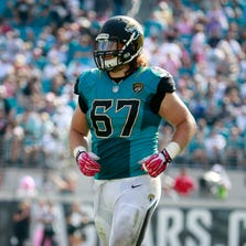 JACKSONVILLE, FL - OCTOBER 20:   Austin Pasztor #67 of the Jacksonville Jaguars in action during the game against the San Diego Chargers at EverBank Field on October 20, 2013 in Jacksonville, Florida.  (Photo by Sam Greenwood/Getty Images)