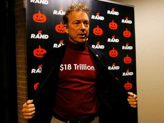 Republican presidential candidate Rand Paul shows off his national debt costume Friday, Oct. 30, 2015, during the Rand Paul Liberty Halloween Party at Buzzard Billy's in Des Moines.