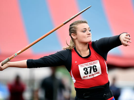 New Oxford's Madi Smith competes in the Class 3A javelin