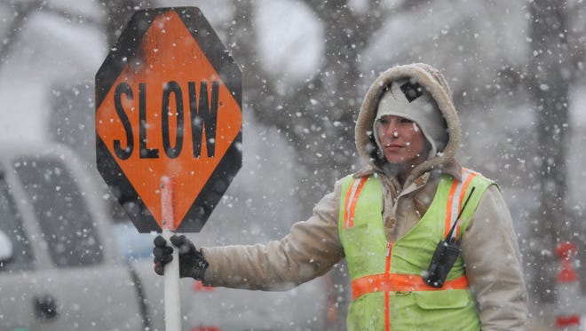 In 2007: Traffic controller Jessica Crosthwaite endures the chill during a snow flurry on Friday morning as she directs traffic at a work site on Sixth and Sutro streets.