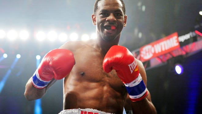 Jamel Herring (red/white/blue) poses  after defeating Victor Galindo (not pictured) in a lightweight bout at Boardwalk Hall in May of 2013. Herring won by first round KO.