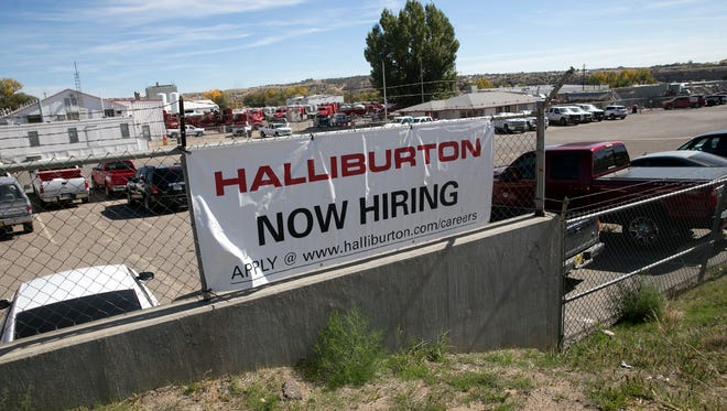 A sign for Halliburton is pictured on Tuesday, Oct. 17, 2017 on East Main Street in Farmington.