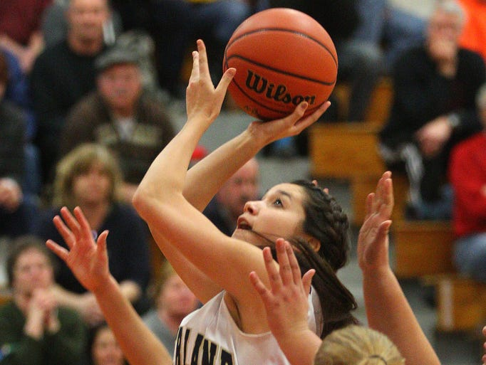 Pittsford Sutherland's Grace DiGiovanni (24) goes to the basket Tuesday.