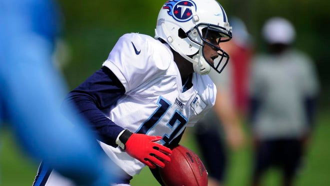 Titans wide receiver Kendall Wright races up the field with a catch during practice at Saint Thomas Sports Park on Tuesday.