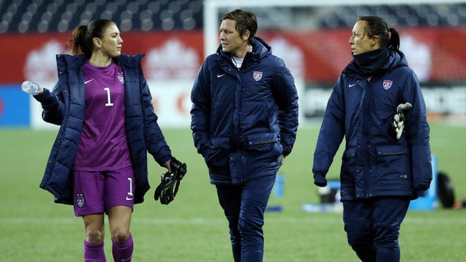 From left, U.S. goalkeeper Hope Solo, forward Abby Wambach and goalkeeper Jill Loyden after a game in May in Winnipeg, Canada. Solo, charged with two counts of misdemeanor domestic violence in the assault of her sister and 17-year-old nephew, has pleaded not guilty and is awaiting trial in November.