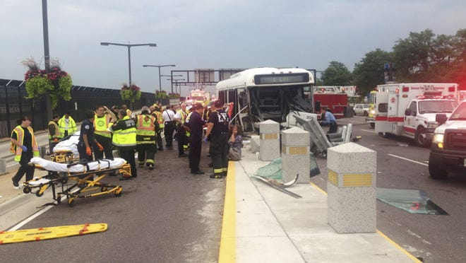 This image from video provided by WBBM-TV in Chicago shows emergency personnel at the scene of a shuttle bus accident after it hit a concrete barrier on a road leading to the terminals at Chicagoís OíHare International Airport Monday morning, Aug. 29, 2014. A Chicago Police Department spokesperson says 15 people were taken to hospitals. There is no information on their condition. (AP Photo/Courtesy of WBBM-TV Chicago, Mike Puccinelli) ORG XMIT: CX101