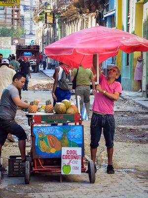 A street vendor waits for customers in Havana on Dec. 18.