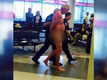 Man takes off clothes at Charlotte Douglas