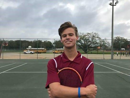 Pensacola High senior tennis player Stanley Dorion,