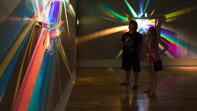 Illinois residents, Ian Wagner, left, and Morgan Leon, right, take a little time to visit the Pensacola Museum of Art while in area on vacation.