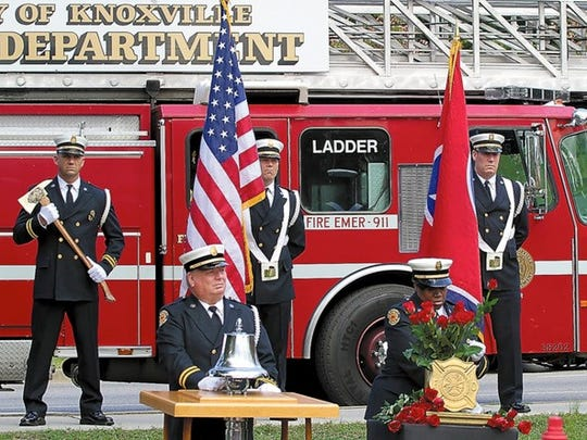 Knoxville Fire Department Capt. Rex Wilson rings a bell for fallen firefighters as Capt. Carla Jones places roses in a vase during the 106th annual City of Knoxville Fire Department Memorial Service.