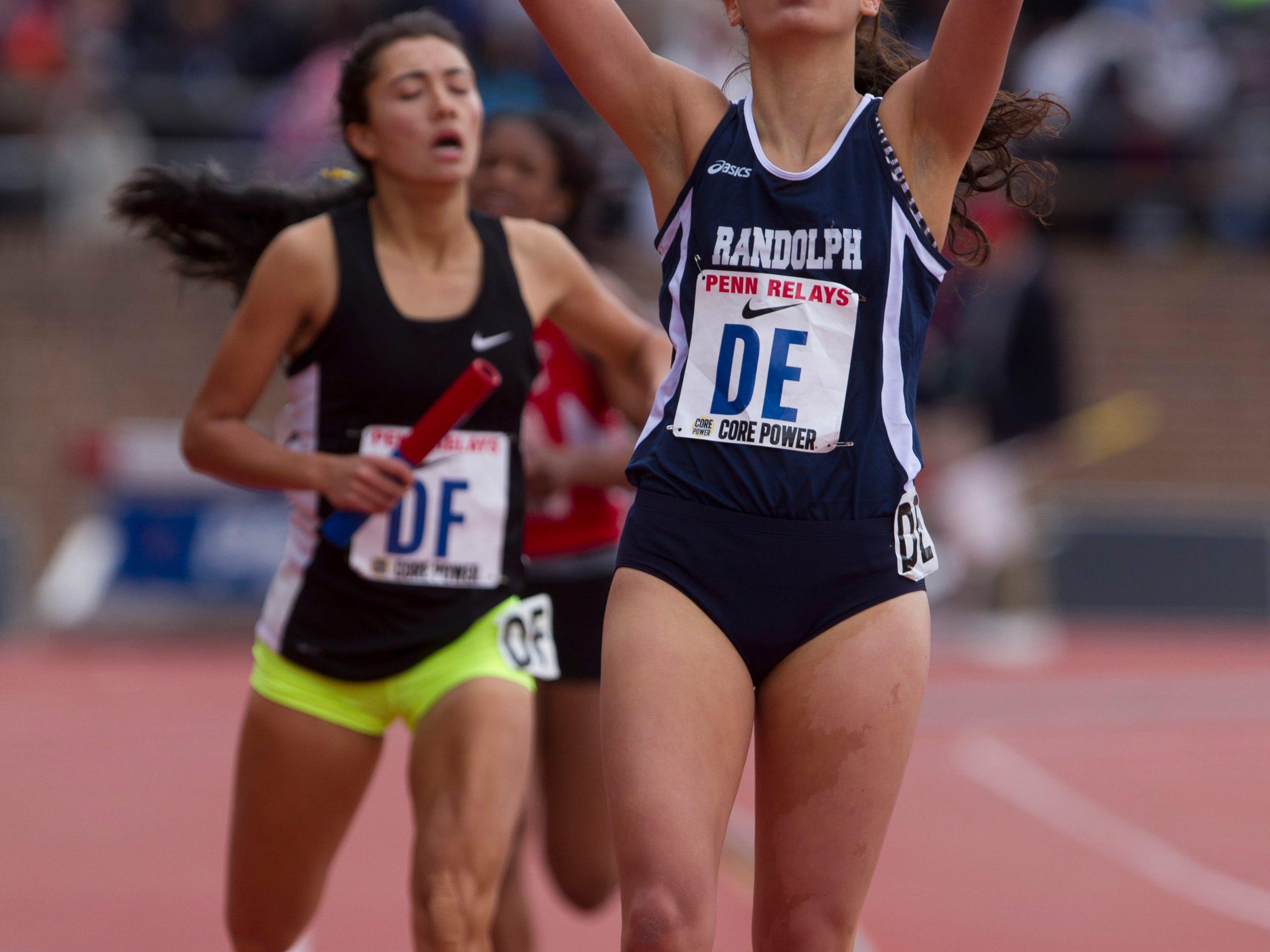 Randolph senior Liz Lansing points skyward as she crosses the finish line in a large-school 4x800 heat on Thursday at Penn Relays.