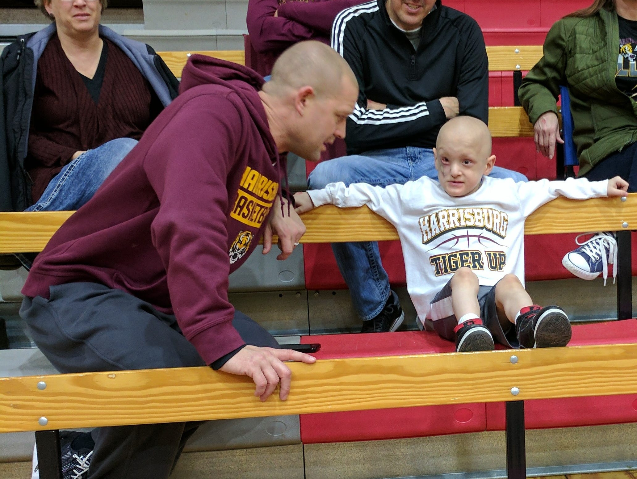 Emmett chats with Harrisburg coach Scott Langerock.