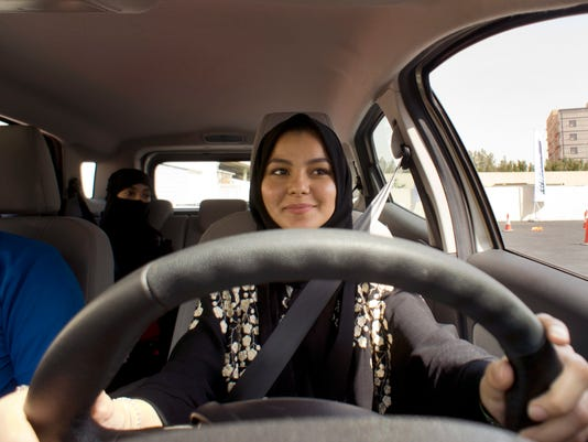 AP SAUDI WOMEN STEER THE WHEEL I SAU
