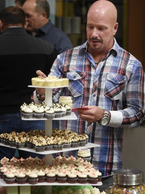 Gary Fagan tries to decide which Gigi's cupcake to try at the 2017 Taste of Williamson County. This year's fundraiser for United Way of Williamson County is set for 7-9 p.m. Sunday, March 4.