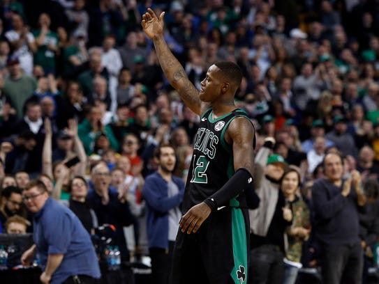Boston Celtics guard Terry Rozier urges on the crowd