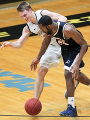 Catawba guard Jameel Taylor steals the ball from Anderson sophomore forward Jeremy Bouton late in the second half on Saturday at Anderson University.