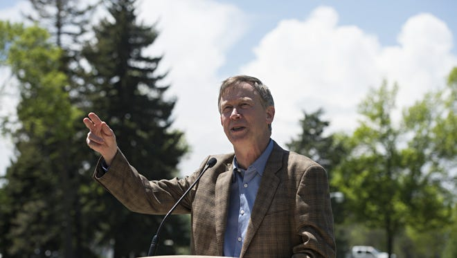 Governor John Hickenlooper speaks at the CSU Annual Flower Trial Garden during a stop in Fort Collins on May 18, 2016.