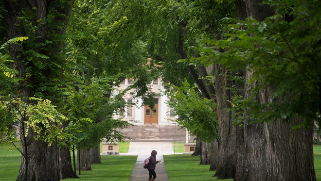 A CSU student walks through the Oval on campus last fall. Students can expect a tuition hike for 2018-19 that outpaces the cost of inflation, he university's chief financial officer said Wednesday.