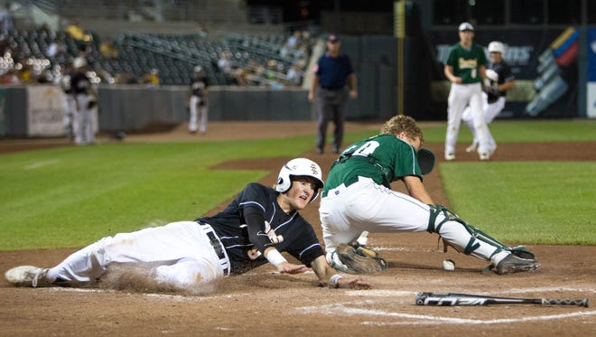 Southeast Polk High School's TJ Fetters  slides around Hempstead's Brady Breitbach (20) in the fourth inning Friday, Aug. 1, 2014, during the 2014 IHSAA Class 4A State Baseball Tournament at Principal Park in Des Moines.