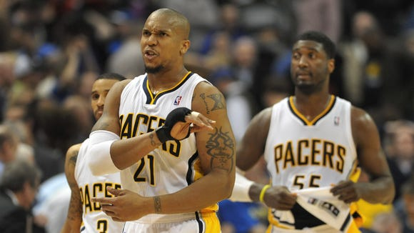 Indiana's David West reacts as the Pacers fourth quarter effort fell short and the Golden State Warriors defeated the Indiana Pacers 98-96 at Bankers Life Fieldhouse Tuesday March 4, 2014. Behind him are George Hill and Roy Hibbert.
