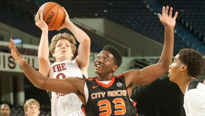 The Ville's Jax Levitch (Trinity H.S.) puts up a shot defended by The (Albany, NY) City Rocks' Emmitt Holt. Louisville beat Albany, N.Y. to capture the AAU 11th grade high school basketball championship. 28 July 2014