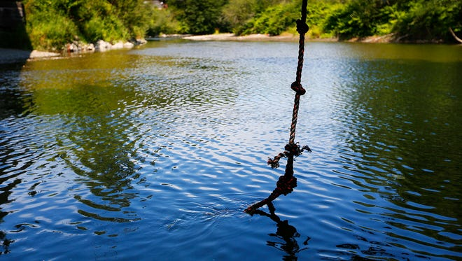 The rope swing over the Pilchuck River where an 8-year-old boy was attacked by an otter and pulled into the river. The boy's grandmother intervened, pulling the otter off, but was seriously injured by the otter.