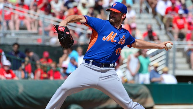 Mets starting pitcher Jonathon Niese delivers a pitch against the St. Louis Cardinals at Roger Dean Stadium. The Mets defeated the Cardinals 9-8.