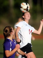 Kaylee Couder, right, battles for control of the ball during a 2016 soccer match against Friday Harbor. Couder was the Sea-Tac League MVP as a freshman and leads the team in scoring this year, while also excelling as a cross country runner.