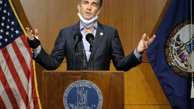 Virginia Gov. Ralph Northam answers a question about the state's COVID-19 status during a press conference at the Patrick Henry Building in Richmond, Va., on Tuesday.