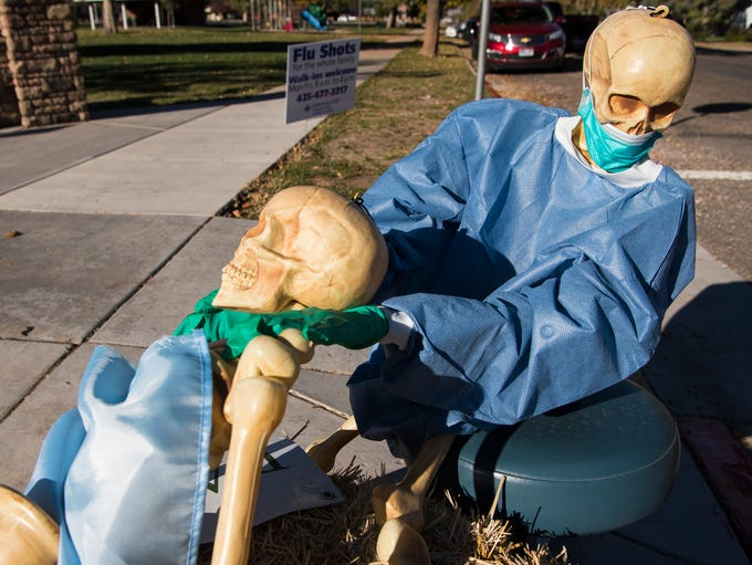 A scarecrow giving a dental exam, built by Parowan