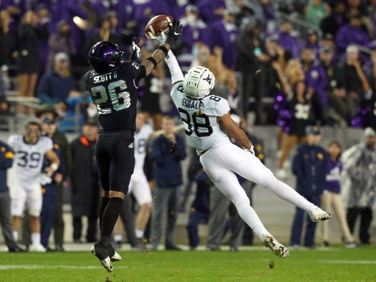 TCU safety Vernon Scott (26) tries to grab a pass intended for West Virginia wide receiver Isaiah Esdale (88) in an NCAA college football game Friday, Nov. 29, 2019, in Fort Worth, Texas. (AP Photo/Richard W. Rodriguez)