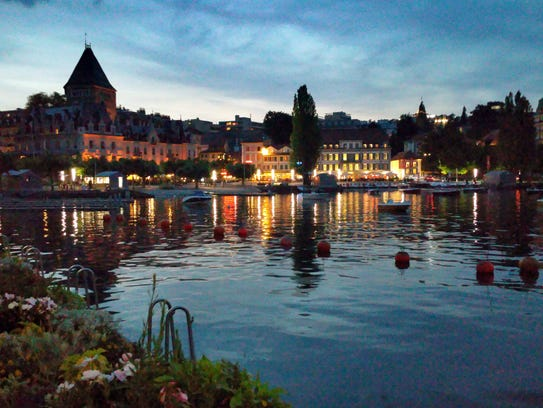Twilight view of the lakeside promenade in Lausanne,