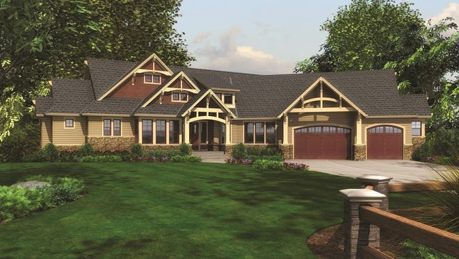 A series of trusses draws your eye to the entrance of this luxurious home.