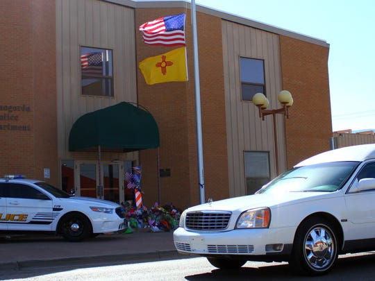 The procession for Alamogordo Police Department officer Clint Corvinus made one last trip passed ADP headquarters Saturday. Corvinus' hearse pauses for a moment of silence in his honor.