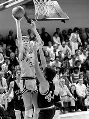 Philip Hutcheson (32) scores two of his game-high 38 points for David Lipscomb in a triple-overtime loss to Macon County in 1986.